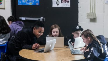 iLEAD Lancaster Charter School learners with laptops