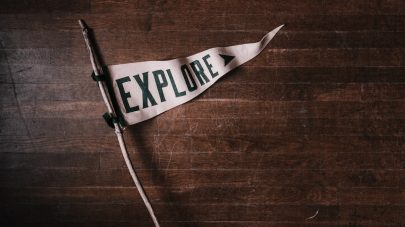"Stick with banner that says ""Explore"""