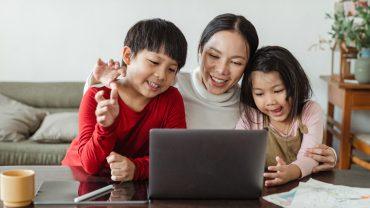 iLEAD Lancaster mom, son and daughter around laptop